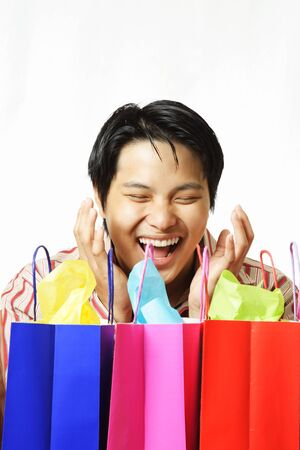 sales person: An isolated shot of a happy young man with shopping bags