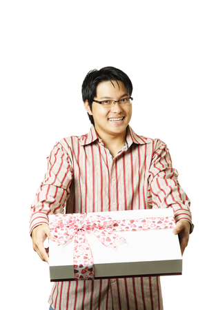 An isolated shot of a young man giving a gift photo