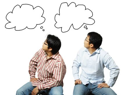 clues: A conceptual shot of two businessmen looking at their own thoughts Stock Photo