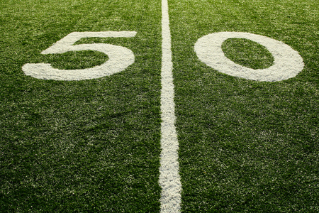 yardline: A shot of a 50 yardline at an american football field