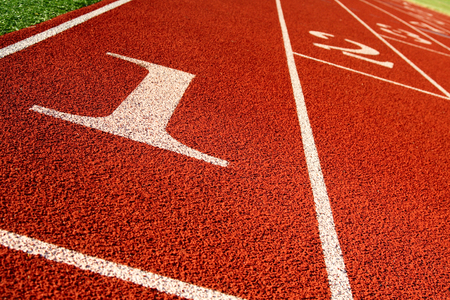 A shot of a running track and field start line Imagens