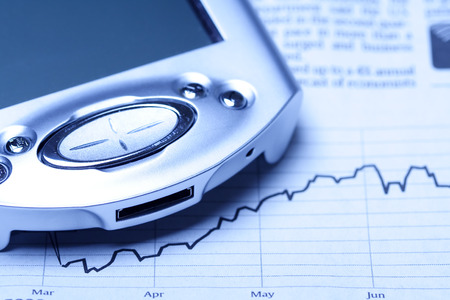 dayplanner: A shot of a PDA on top of financial chart in blue tone