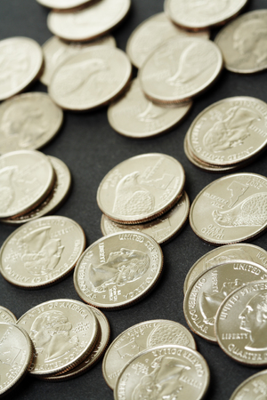 25 cents: A shot of a bunch of new american dollar coins