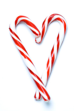 A shot of christmas candy cane in a heart shape photo