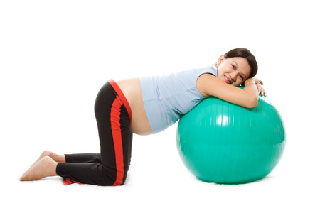 A pregnant woman doing relaxation with birth ball photo