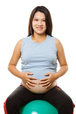 A shot of a pregnant woman sitting on an exercise ball Stock Photo - 1737191