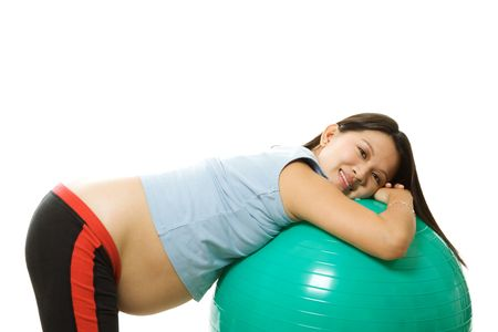 A pregnant woman doing a breathing exercise with an exercise ball Stock Photo - 1737189