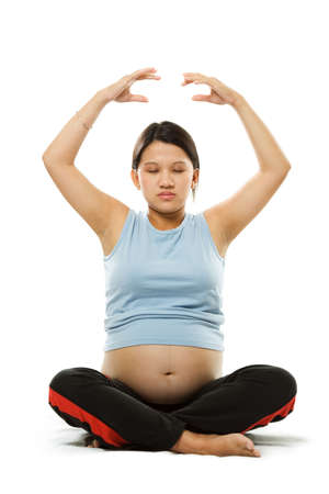 A shot of a pregnant woman meditating Stock Photo - 1737188