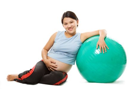 A shot of a beautiful pregnant woman with an exercise ball Stock Photo - 1737190
