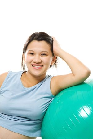 A shot of a beautiful pregnant woman with an exercise ball photo