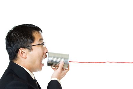 An isolated shot of a businessman communicating with a tin can phone photo