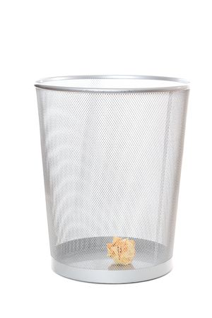 An isolated shot of a crumpled paper in  a trash can