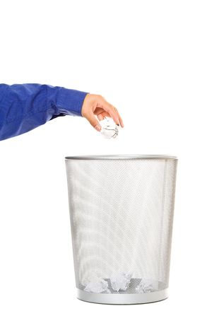 A businessman throwing out trash paper into a trash can Imagens