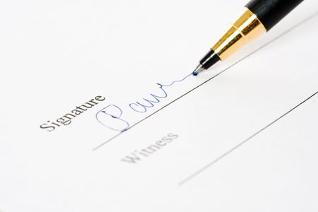 A shot of of a document signing photo