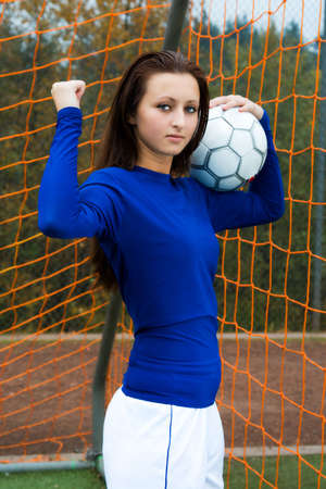 A shot of a happy beautiful soccer player