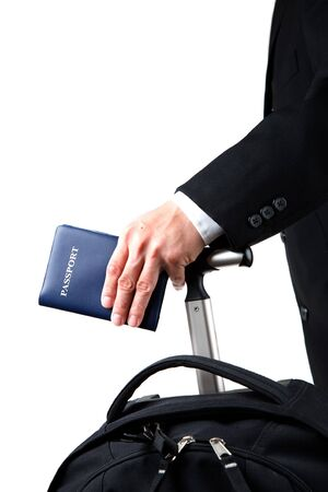 An isolated a travelling businessman carrying a passport and a luggage photo