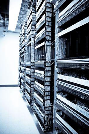 A shot of servers and hardwares in an internet data center  Stock Photo