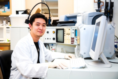 A shot of a scientist working on a computer in a laboratory