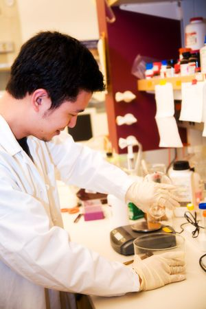 A scientist doing a research at a laboratory photo
