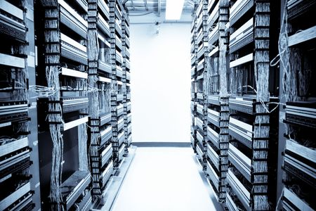 A shot of servers and hardwares in an internet data center  photo