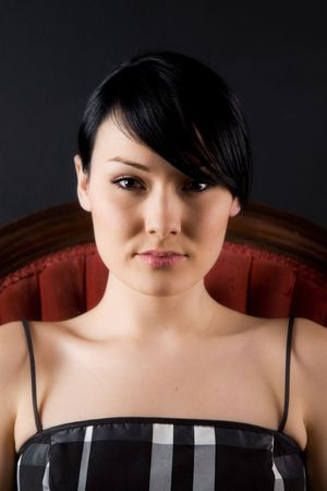 antique chair: A headshot of a beautiful girl sitting on a vintage chair