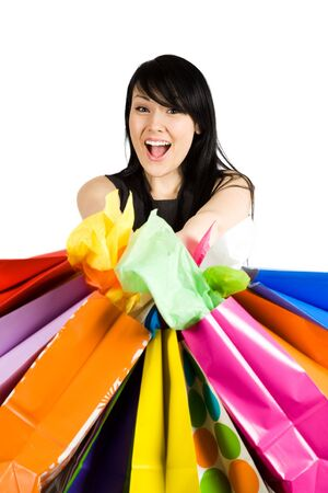 shopaholics: An isolated shot of a beautiful woman carrying shopping bags Stock Photo