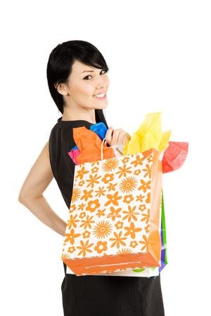 native american girl: An isolated shot of a beautiful woman carrying shopping bags Stock Photo