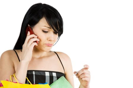 A shopping woman calling her credit card company  photo