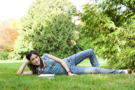 A beautiful college student studying at a park Stock Photo - 2498101
