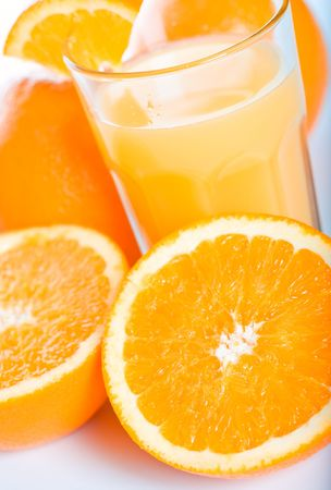 Slices of oranges and a glass of orange juice photo