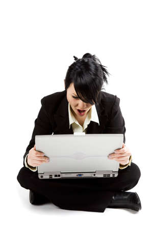 A shocked and surprised businesswoman looking at her laptop Stock Photo - 2514870