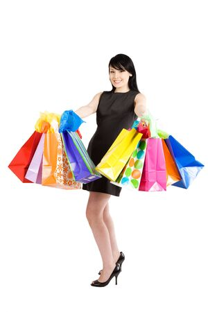 An isolated shot of a beautiful woman carrying shopping bags Stock fotó