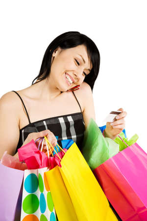 A woman carrying shopping bags and talking on the phone Stock Photo - 2570529