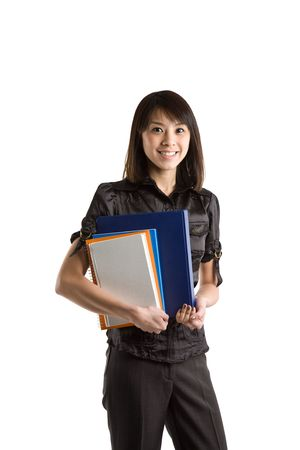 study: An isolated shot of a beautiful asian student carrying books Stock Photo