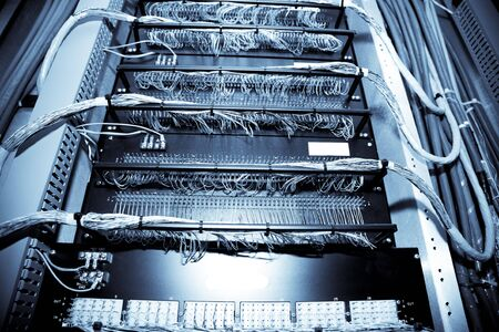 A shot of network equipment in a data center (in blue tone) Stock fotó