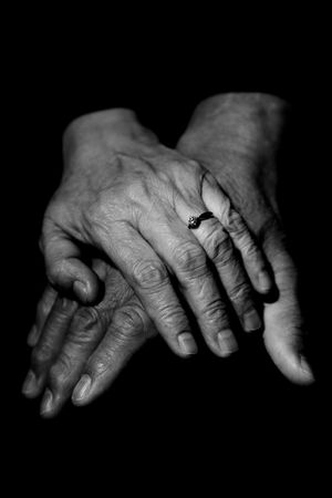 elderly hands: A couple of mature couple holding hands in black and white Stock Photo