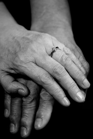 touching hands: A shot of a mature couple holding hands