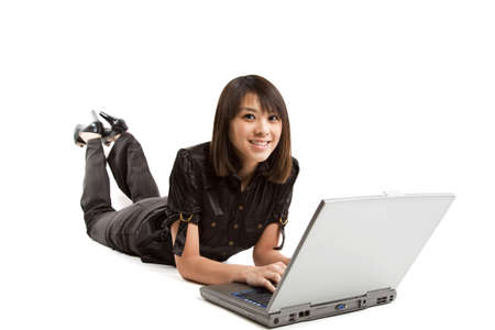 An isolated shot of a woman working on her laptop Stock Photo - 2642797