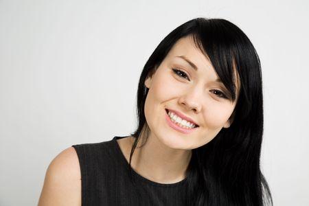 A headshot of a beautiful smiling businesswoman photo