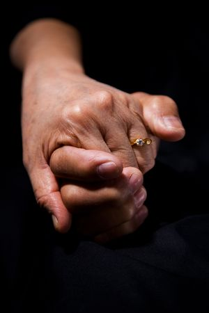 touching: A shot of a senior couple holding hands