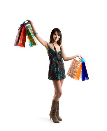 An isolated shot of a beautiful asian woman carrying shopping bags Stock Photo - 2685383