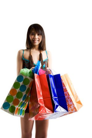An isolated shot of a beautiful asian woman carrying shopping bags Stock fotó - 2685384