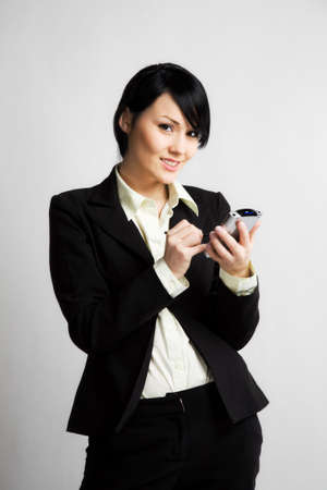 personal digital assistant: A shot of a businessman working on her PDA
