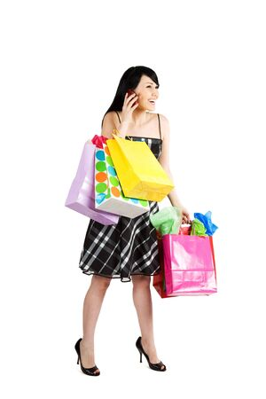 An isolated shot of a beautiful woman carrying shopping bags photo