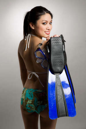 sexy asian woman: A shot of a beautiful asian woman wearing bikini and carrying snorkeling equipment