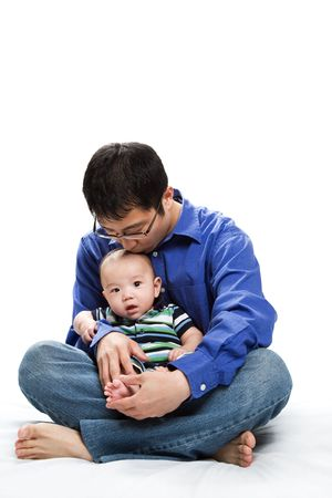 A shot of an asian father with his baby son