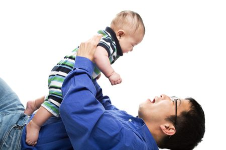 An isolated shot of an asian father and a son cuddling Stock Photo - 2820361