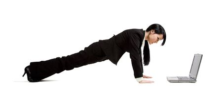 A shot of a businesswoman doing pushup while working on her laptop Stock Photo - 2830658