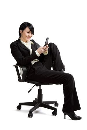 An isolated shot of a businesswoman texting with her cellphone photo