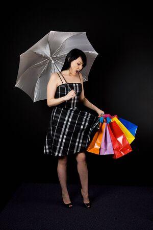 A shot of a beautiful woman carrying shopping bags photo